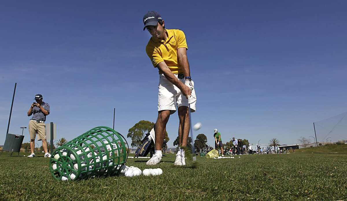Joel Stalter practices on the driving range at the Metropolitan Golf Links in Oakland, Calif. on Friday, March 1, 2013. Stalter is among the top golfers on the Cal Bears' golf team, which is currently the top-ranked collegiate team in the nation.