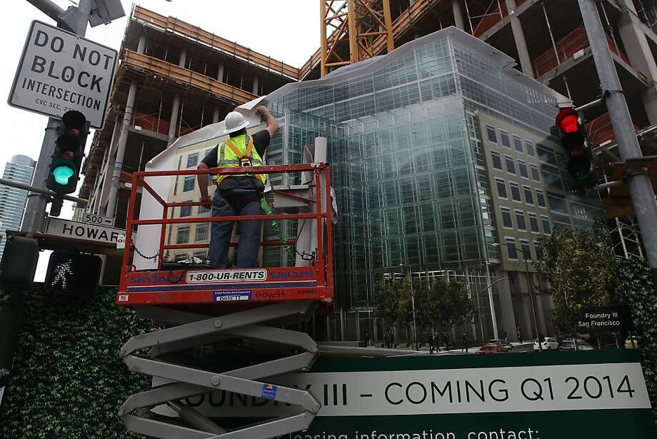 Construction proceeds on the Foundry Square III building in SoMa, which is seeing a boom in housing and office space. Photo: Liz Hafalia, The Chronicle