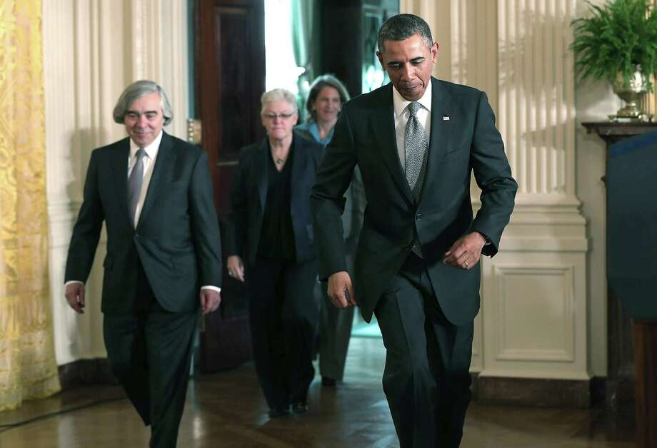 President Barack Obama picked Ernie Moniz, left, Gina McCarthy, center, and Sylvia Mathews Burwell to lead the Energy Department, Environmental Protection Agency and the budget office, respectively. McCar-thy, who has worked for Democrats and Republicans, has led the EPA's air pollution division since 2009. Photo: Win McNamee, Staff / 2013 Getty Images