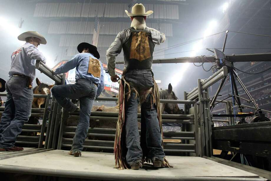 Evan Jayne looks out into the stadium as he gets ready to compete in Bareback Riding during the BP Super Series III Round 2 at Reliant Stadium on Monday, March 4, 2013, in Houston. Photo: Mayra Beltran, Houston Chronicle / © 2013 Houston Chronicle