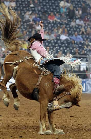 Kaycee Feild competes in Bareback Riding during the BP Super Series III Round 2 at Reliant Stadium o