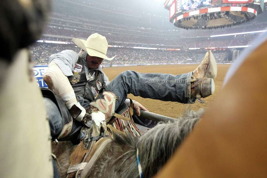 Evan Jayne is seconds away from competing in Bareback Riding during the BP Super Series III Round 2 at Reliant Stadium on Monday, March 4, 2013, in Houston. Photo: Mayra Beltran, Houston Chronicle / © 2013 Houston Chronicle