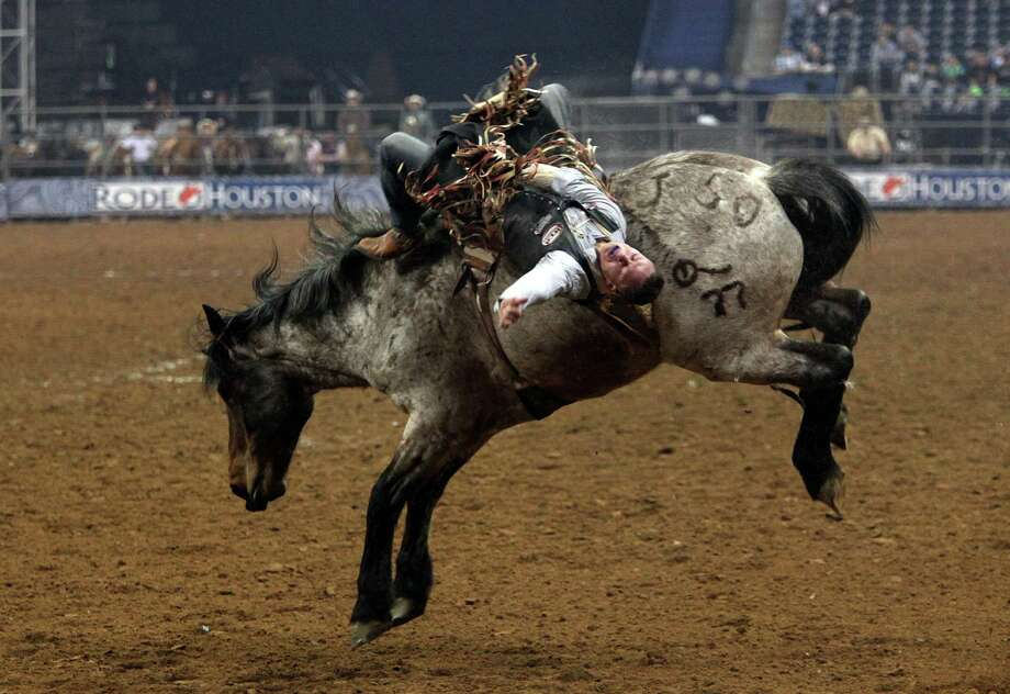 Evan Jayne competes in Bareback Riding during the BP Super Series III Round 2 at Reliant Stadium on Monday, March 4, 2013, in Houston. Photo: Mayra Beltran, Houston Chronicle / © 2013 Houston Chronicle