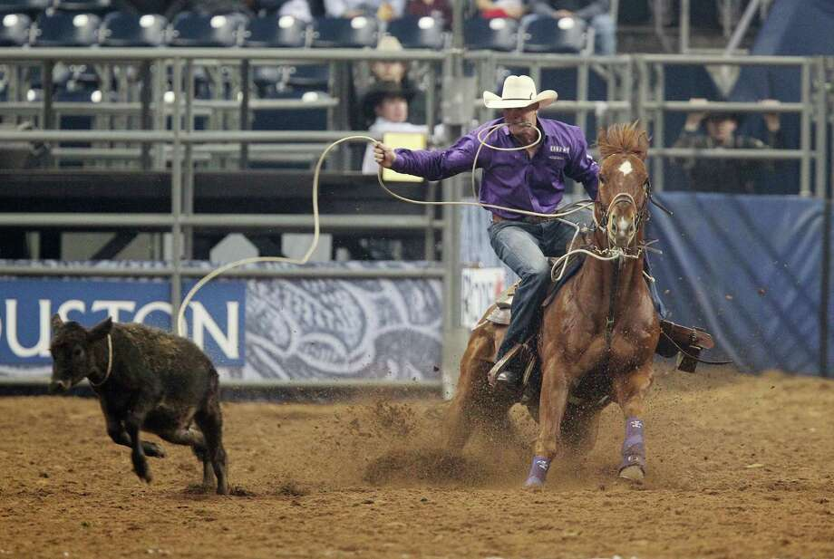 Logan Hofer competes in Tie-Down Roping during the BP Super Series III Round 2 at Reliant Stadium on Monday, March 4, 2013, in Houston. Photo: Mayra Beltran, Houston Chronicle / © 2013 Houston Chronicle