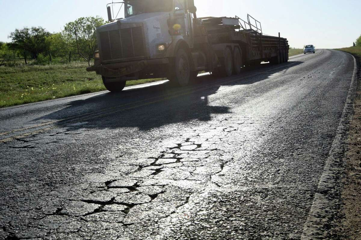 A truck in the oil and gas industry drives near Cotulla. One Texas representative has filed a bill to use $1.4 billion from the rainy day fund to repair roads in counties affected by such traffic.