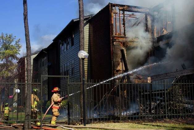 Up to 160 firefighters responded Monday to battle a 3-alarm blaze at an apartment complex in north Houston. Photo: Cody Duty, Staff / © 2013  Houston Chronicle