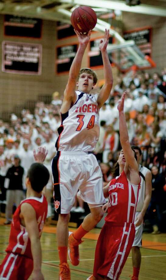 Ridgefield High School's Kurt Steidl goes up for a shot against Greenwich High School in the Class LL game played at Ridgefield. Mar. 4, 2013 Photo: Scott Mullin