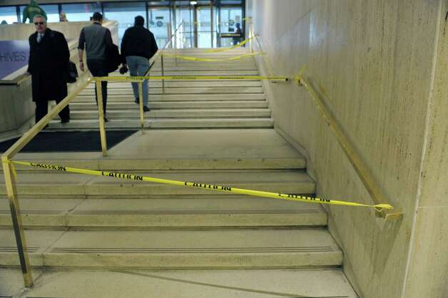 The scene of where a New York State Trooper was attacked is marked off with caution tape just inside the Madison Ave. entrance to the Empire State Plaza Concourse area on Monday, March 4, 2013 in Albany, NY.  (Paul Buckowski / Times Union) Photo: Paul Buckowski