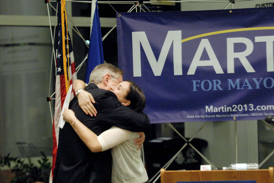 Democrat David Martin of the Board of Finance gets a hug from his daughter, Sarah Martin, as he announces his second mayoral campaign with a conference in the lobby of the Government Center in Stamford, Conn., March 4, 2013. Photo: Keelin Daly / Keelin Daly