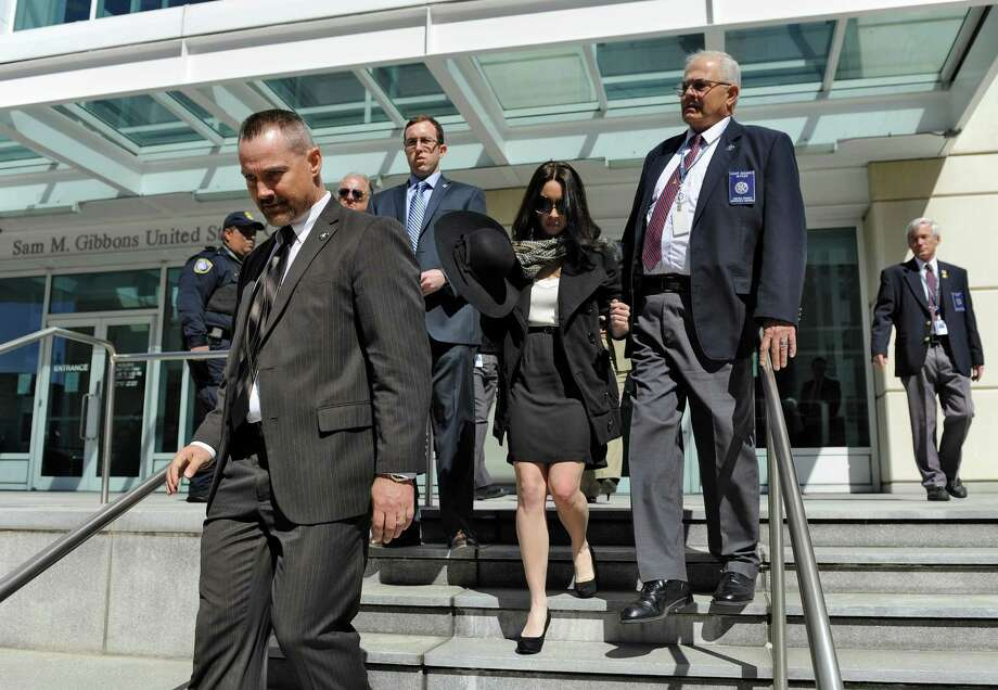 Casey Anthony, center, leaves the United States Courthouse in Tampa, Fla., with U.S. Marshals after a bankruptcy hearing Monday, March 4, 2013, in Tampa, Fla. Anthony has not made any public appearances since she left jail after being acquitted in 2011 for the murder of her two-year-old daughter Caylee. (AP Photo/Brian Blanco) Photo: Brian Blanco, FRE / FR1701907 AP