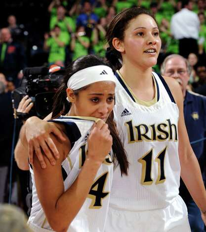 Notre Dame guard Skylar Diggins, left, gets a hug from Natalie Achonwa after their 96-87 triple overtime win over Connecticut in an NCAA college basketball game, Monday, March 4, 2013, in South Bend, Ind. Diggins scored 29 points. (AP Photo/Joe Raymond) Photo: Joe Raymond, Associated Press / FR25092 AP