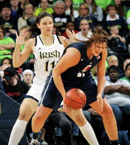 Connecticut center Stefanie Dolson, right, gets bumped by Notre Dame forward Natalie Achonwa during the first half of an NCAA college basketball game, Monday, March 4, 2013, in South Bend, Ind. (AP Photo/Joe Raymond) Photo: Joe Raymond, Associated Press / FR25092 AP