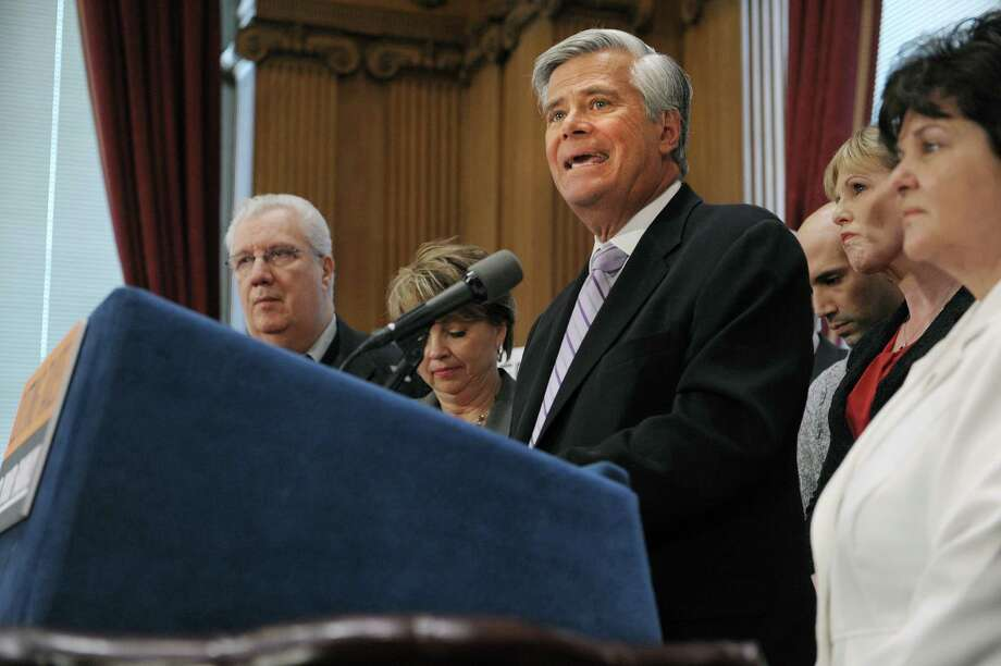 Senate Republican Conference Leader Dean Skelos, center, and members of the Senate Republican Conference, unveil their Family Tax Relief Act during a press conference at the Capitol on Monday, March 4, 2013 in Albany, NY.  (Paul Buckowski / Times Union) Photo: Paul Buckowski