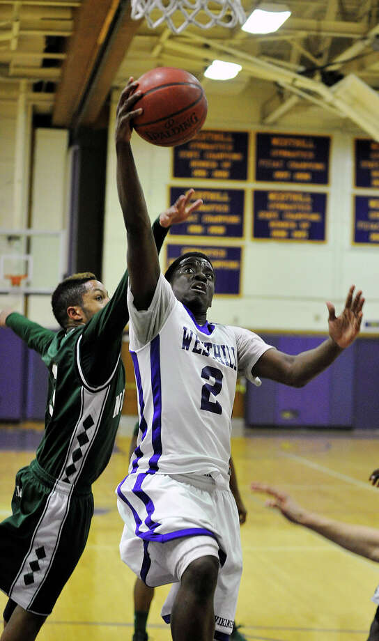 Westhill's Terrell Middleton shoots while under pressure from Norwalk's Jeremy Linton during their game at Westhill High School on Monday, March 4, 2013. Westhill won, 60-50. Photo: Jason Rearick / The Advocate