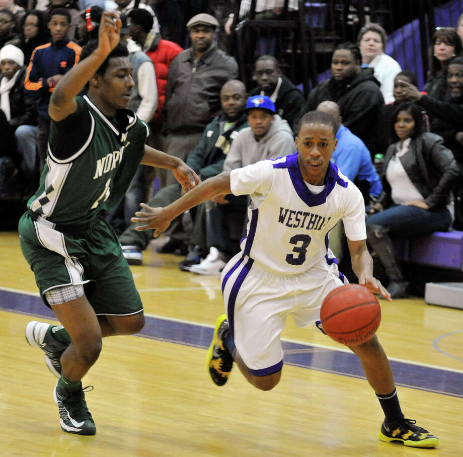 Westhill's CJ Donaldson drives to the basket around Norwalk's Jabari Dear during their game at Westhill High School on Monday, March 4, 2013. Westhill won, 60-50. Photo: Jason Rearick / The Advocate