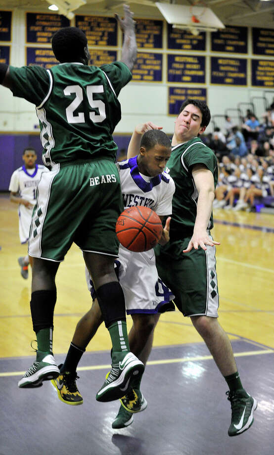 Westhill's CJ Donaldson looses control of the ball after being sandwiched by Norwalk's Saeed Soulemane, left, and Sean Butler during their game at Westhill High School on Monday, March 4, 2013. Westhill won, 60-50. Photo: Jason Rearick / The Advocate