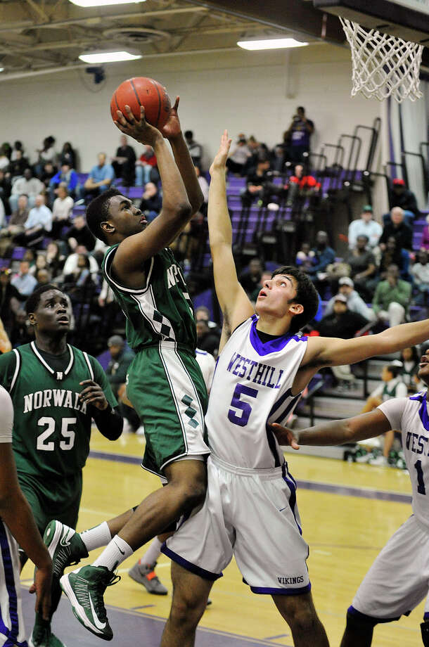 Norwalk's Zaire Wilson shoots over Westhill's Evan Skoparantzas during their game at Westhill High School on Monday, March 4, 2013. Westhill won, 60-50. Photo: Jason Rearick / The Advocate