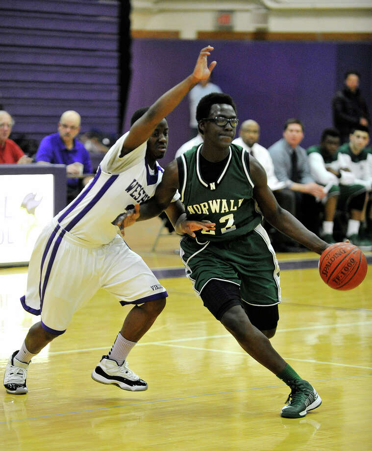 Norwalk's Roy Kane drives around Westhill's Terrell Middleton during their game at Westhill High School on Monday, March 4, 2013. Westhill won, 60-50. Photo: Jason Rearick / The Advocate