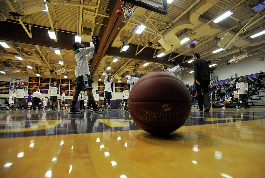 Norwalk players do warmups before their game against Westhill at Westhill High School on Monday, March 4, 2013. Photo: Jason Rearick / The Advocate