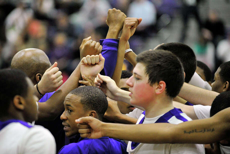 The Westhill team huddles before their game against Norwalk at Westhill High School on Monday, March 4, 2013. Photo: Jason Rearick / The Advocate