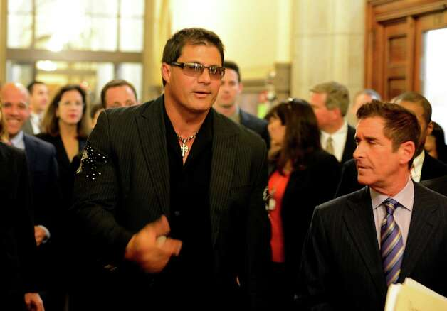 Former major league baseball player Jose Canseco, left  speaks with Co-Leader of the Senate Jeff Klein as he arrives at the Capitol March 4, 2013 to speak to a Senate committee about the dangers of the drug DMAA and other performance enhancing drugs  (Skip Dickstein/Times Union) Photo: SKIP DICKSTEIN