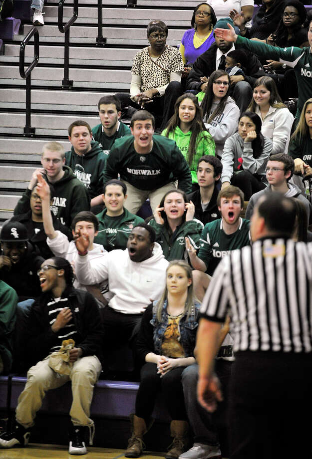 Norwalk fans react to a call against their team at Westhill High School on Monday, March 4, 2013. Photo: Jason Rearick / The Advocate