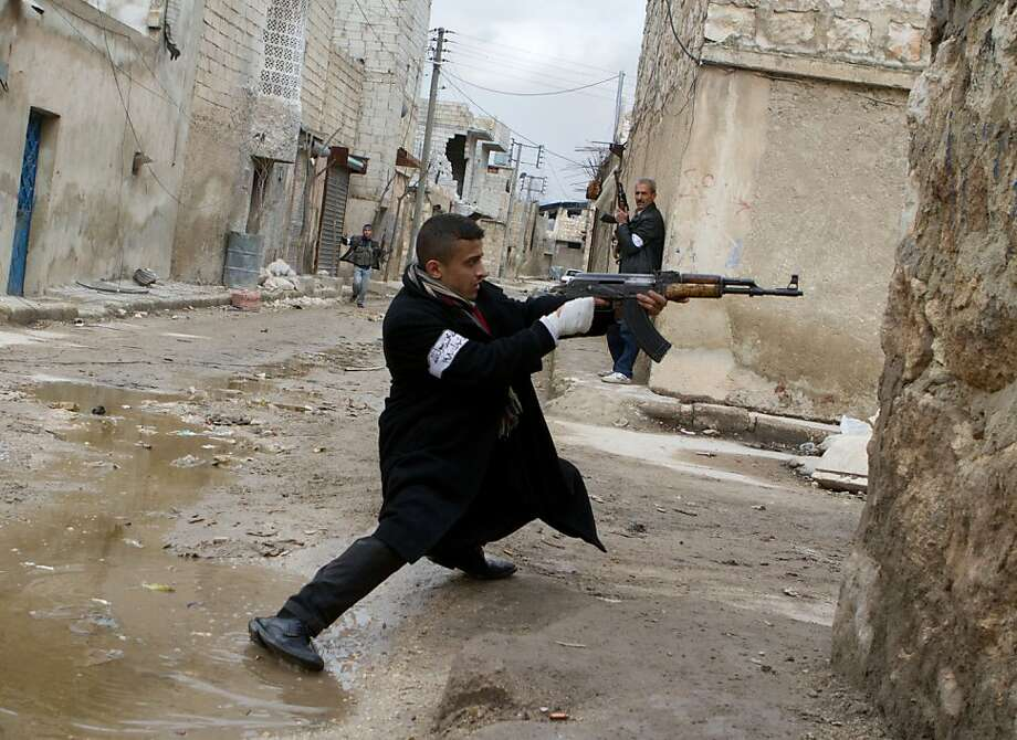 A Syrian rebel aims his weapon during clashes with government forces in the streets near Aleppo international airport in northern Syria on March 4, 2013. Syria is locked in a nearly two-year-old conflict in which the United Nations estimates that more than 70,000 people have been killed.  Photo: Stephen J. Boitano, AFP/Getty Images