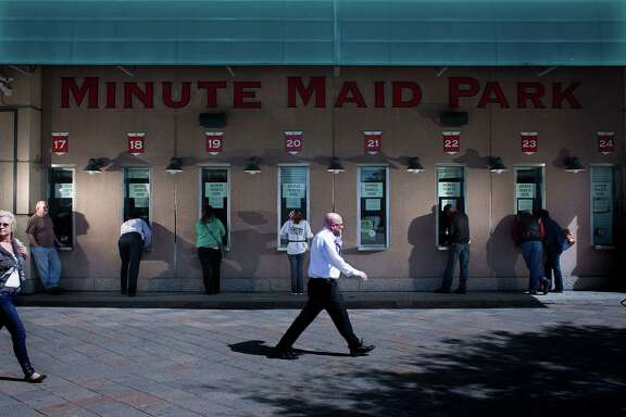 Fans lineup at ticket booths outside of Minute Maid Park on 700 Texas  as the Astros single-game tickets went on sale Sunday, March 3, 2013, in Houston.