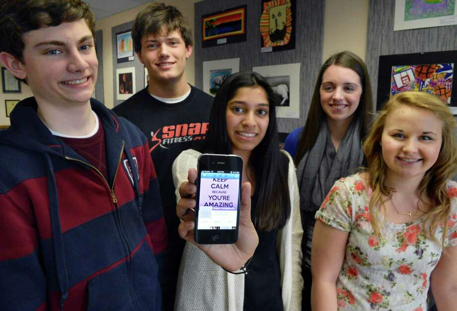 Students at Shaker High, from left, Daniel LaSalle, Kyle Fragnoli, Anum Hussain, Katie McLean and Stephanie Morgan discuss a new Facebook page called Shaker Compliments, where students post praise for each other. Part of a national trend, Shaker's site has inspired at least two others at Shenendehowa and Emma Willard.  (John Carl D'Annibale / Times Union) Photo: John Carl D'Annibale / 00021335A