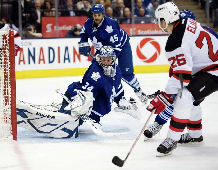 Toronto Maple Leafs goaltender James Reimer makes a save on New Jersey Devils left wing Patrik Elias (26) during the third period of their NHL hockey game, Monday, March 4, 2013, in Toronto. The Maple Leafs won 4-2. (AP Photo/The Canadian Press, Frank Gunn) Photo: Frank Gunn