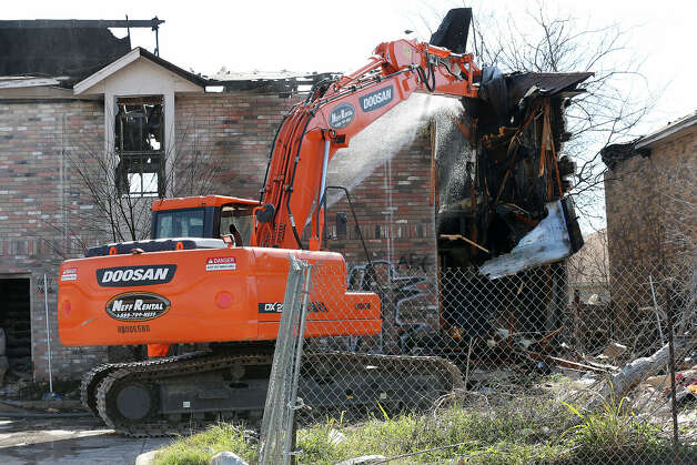 Crews begin demolition of an apartment building in the Windsor Oaks neighborhood in east Bexar County. The owners failed to comply with county cleanup directives.