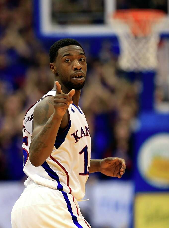 Who's hot - Kansas G Elijah Johnson:Continued his hot streak with 12 points and 10 assists against West Virginia. He's averaging 25.5 points and 8.5 assists and shooting 56.7 percent from the field in his last two games. Photo: Jamie Squire, Getty Images / 2013 Getty Images