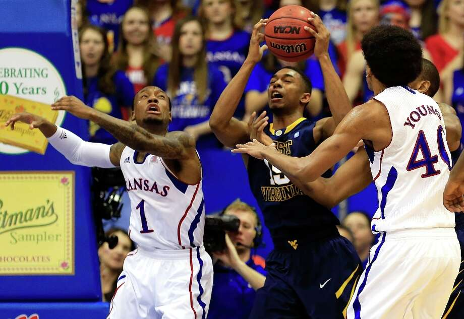Who's hot - West Virginia G Terry Henderson:Came off the bench for 20 points and matched his season high with six 3-pointers against Kansas. Photo: Jamie Squire, Getty Images / 2013 Getty Images