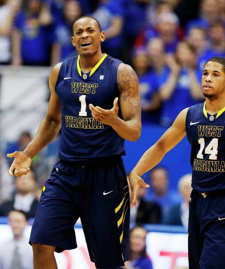 Who's hot - West Virginia F Dominique Rutledge: Produced his first career double-double with 17 points and 13 rebounds in the Mountainteers' loss at Kansas. Photo: Orlin Wagner, Associated Press / AP