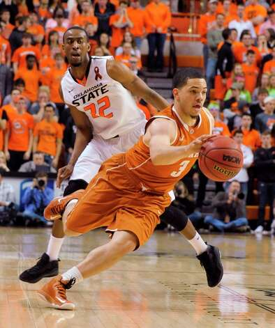 Who's hot - Texas G Javan Felix: The freshman guard produced 13 points against  Oklahoma State. It was his largest scoring effort since notching 26 in the Longhorns' conference opener against Baylor on Jan. 5. Photo: Brody Schmidt, Associated Press / FR79308 AP
