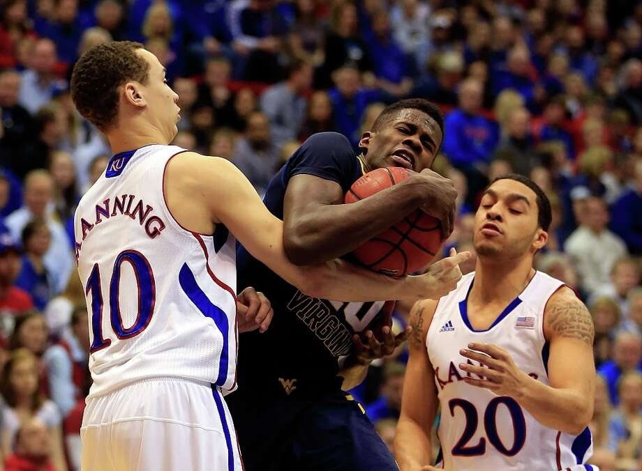 Not - West Virginia G Eron Harris: Clanked through a miserable 4-for-17 shooting performance in the loss to Kansas. Harris is 2 for 16 from behind the 3-point arc (12.5 percent) in his last two games. Photo: Jamie Squire, Getty Images / 2013 Getty Images
