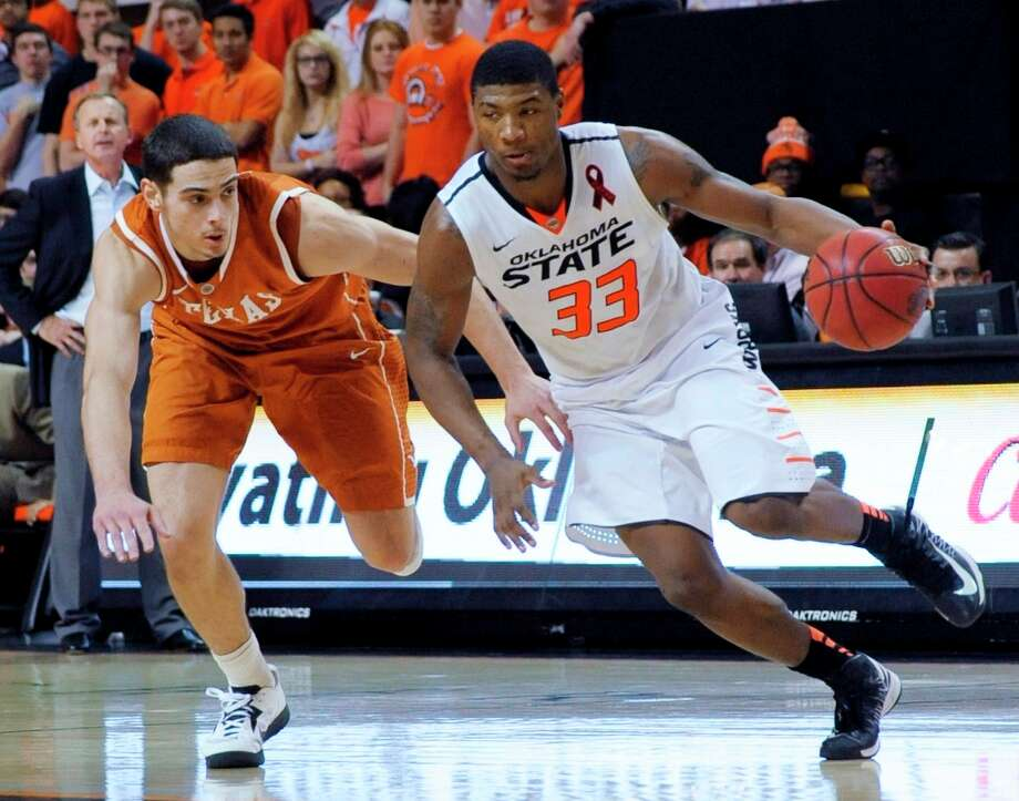 Not - Oklahoma State G Marcus Smart: His recent shooting slump continued as he's hit 12 of 38 from the field (31.6 percent) in the last four games. Photo: BRODY SCHMIDT, Associated Press / FR79308 AP