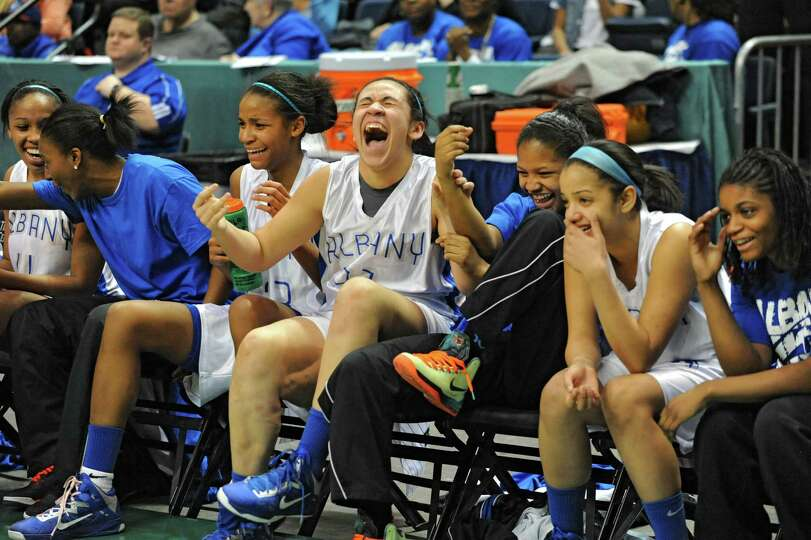The Albany bench starts to celebrate with a minute left in the Class AA girls' championship basketba
