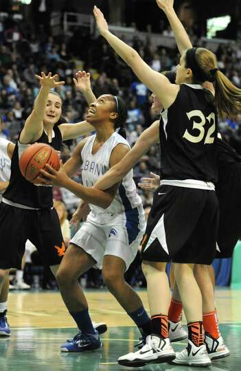 Albany's Emia Willingham-Hust drives to the basket during the Class AA girls' championship basketbal