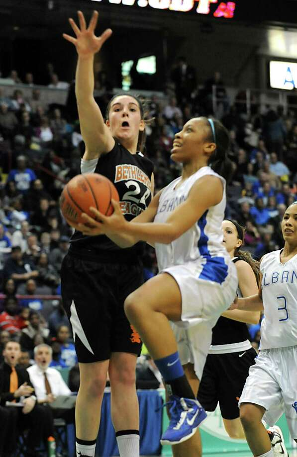 Albany's Emia Willingham-Hurst drives to the basket against Bethlehem's Gabby Giacone during the Class AA girls' championship basketball game at the Times Union Center on Monday March 4, 2013 in Albany, N.Y.  (Lori Van Buren / Times Union) Photo: Lori Van Buren