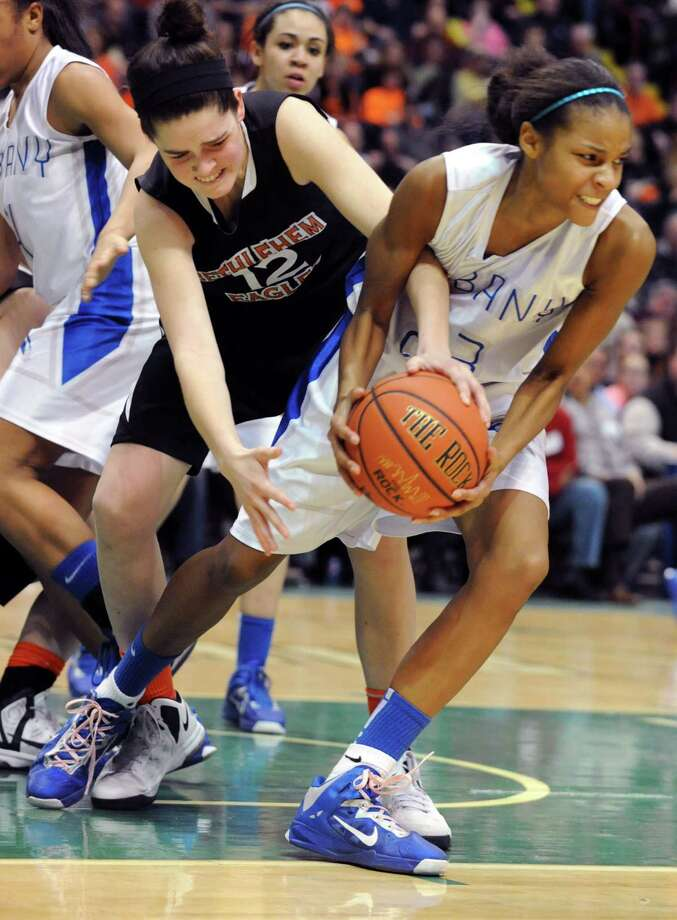 Bethlehem's Jenna Giacone battles for the ball with Albany's Mylah Chandler during the Class AA girls' championship basketball game at the Times Union Center on Monday March 4, 2013 in Albany, N.Y.  (Lori Van Buren / Times Union) Photo: Lori Van Buren