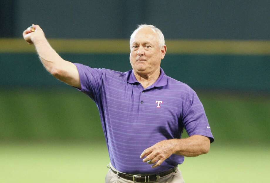 Nolan Ryan, throwing out a first pitch at Minute Maid Park last year, remains popular in Houston despite his ties to the Rangers. Photo: Nick De La Torre, Staff / 2012  Houston Chronicle