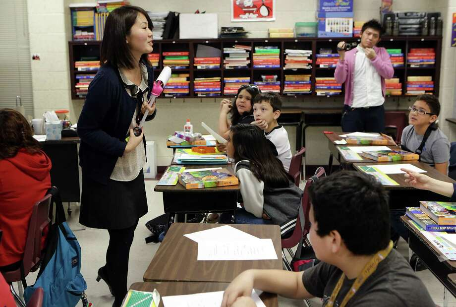 Tomoe Numagami (left), a student teacher from Joestsu University of Education in Japan, leads a class at Elrod Elementary. Photo: Photos By Bob Owen / San Antonio Express-News
