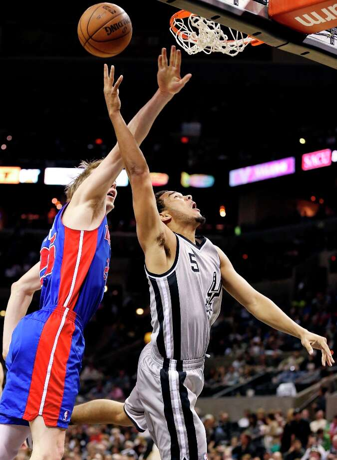 The Spurs' Cory Joseph shoots around Detroit Pistons' Kyle Singler during second half action Sunday, March 3, 2013 at the AT&T Center. The Spurs won 114-75. Photo: Edward A. Ornelas, San Antonio Express-News / © 2013 San Antonio Express-News