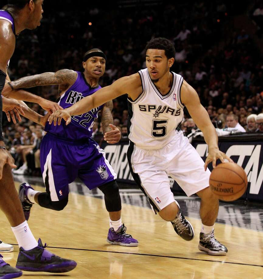 The Spurs' Cory Joseph (5) dribbles around Sacramento Kings' Isaiah Thomas (22) in the second half at the AT&T Center on Friday, Mar. 1, 2013. Spurs defeated the Kings 130-102. Photo: Kin Man Hui, San Antonio Express-News / © 2012 San Antonio Express-News