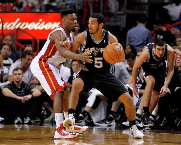 The Spurs' Cory Joseph (5) drives as the Heat's Norris Cole (30) defends  Thursday, Nov. 29, 2012,  in Miami. Photo: Alan Diaz, Associated Press / AP