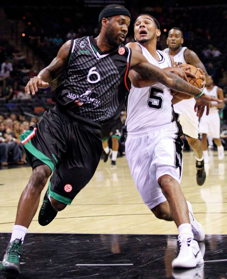 The Spurs' Cory Joseph looks for room around Montepaschi Siena's Bobby Brown during second half action Saturday Oct. 6, 2012 at the AT&T Center. The Spurs won 106-77. Photo: Edward A. Ornelas, San Antonio Express-News / © 2012 San Antonio Express-News