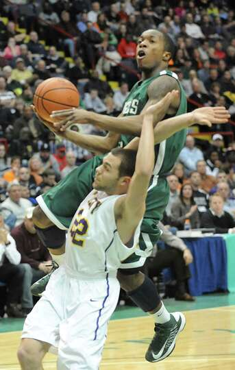 Green Tech's Maurice is fouled by Troy's Imre Megyeri as he drives to the basket during the Class AA