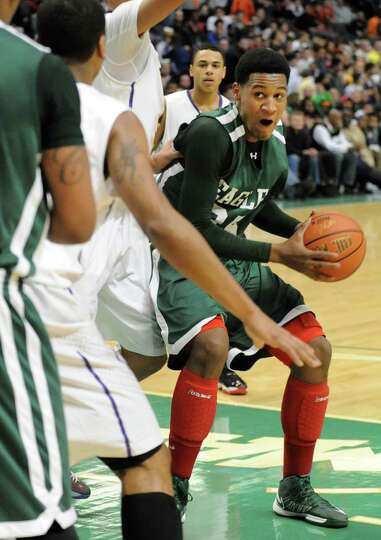 Green Tech's Ramion Burt drives to the basket during the Class AA boys' championship basketball game