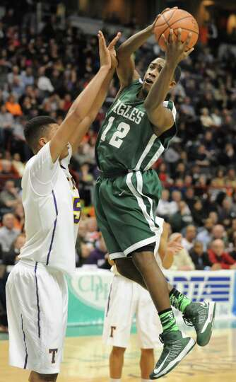 Green Tech's Jamil Hood Jr. drives to the basket during the Class AA boys' championship basketball g